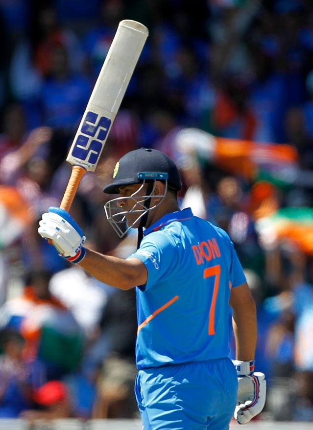 Indian batsman MS Dhoni celebrates his half-century during a match against West Indies in ICC CWC 2019 at Old Trafford in Manchester on Thursday