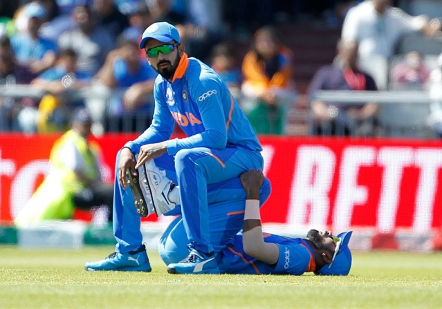 Indian players Lokesh Rahul and Hardik Pandya stretch during the match against West Indies