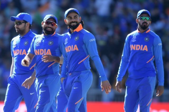 India's captain Virat Kohli (C) and teammates gesture at end of play during the 2019 Cricket World Cup group stage match between West Indies and India.