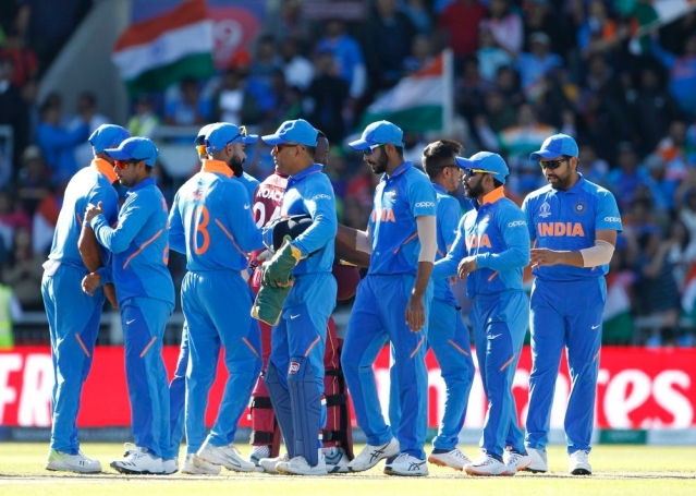 Indian players celebrate after winning the match against West Indies in ICC CWC 2019 at Old Trafford in Manchester on Thursday.