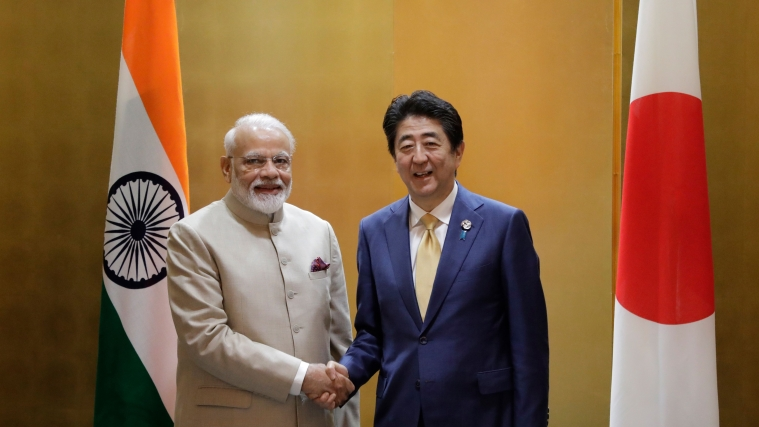 India's Prime Minister Narendra Modi (L) shakes hands with Japan's Prime Minister Shinzo Abe during a bilateral meeting ahead of the Group of 20 (G20) summit in Osaka on June 27, 2019.