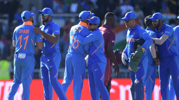 India's players prepare to leave at end of play during the 2019 Cricket World Cup group stage match between West Indies and India at Old Trafford in Manchester