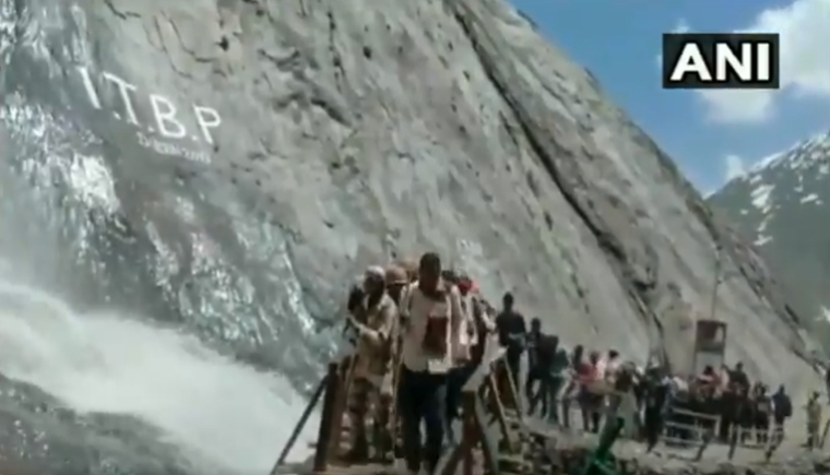 Amarnath Yatra: ITBP personnel protect pilgrims from hurling stones by forming human chain