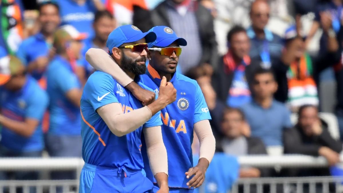 India's captain Virat Kohli (L) with India's Hardik Pandya