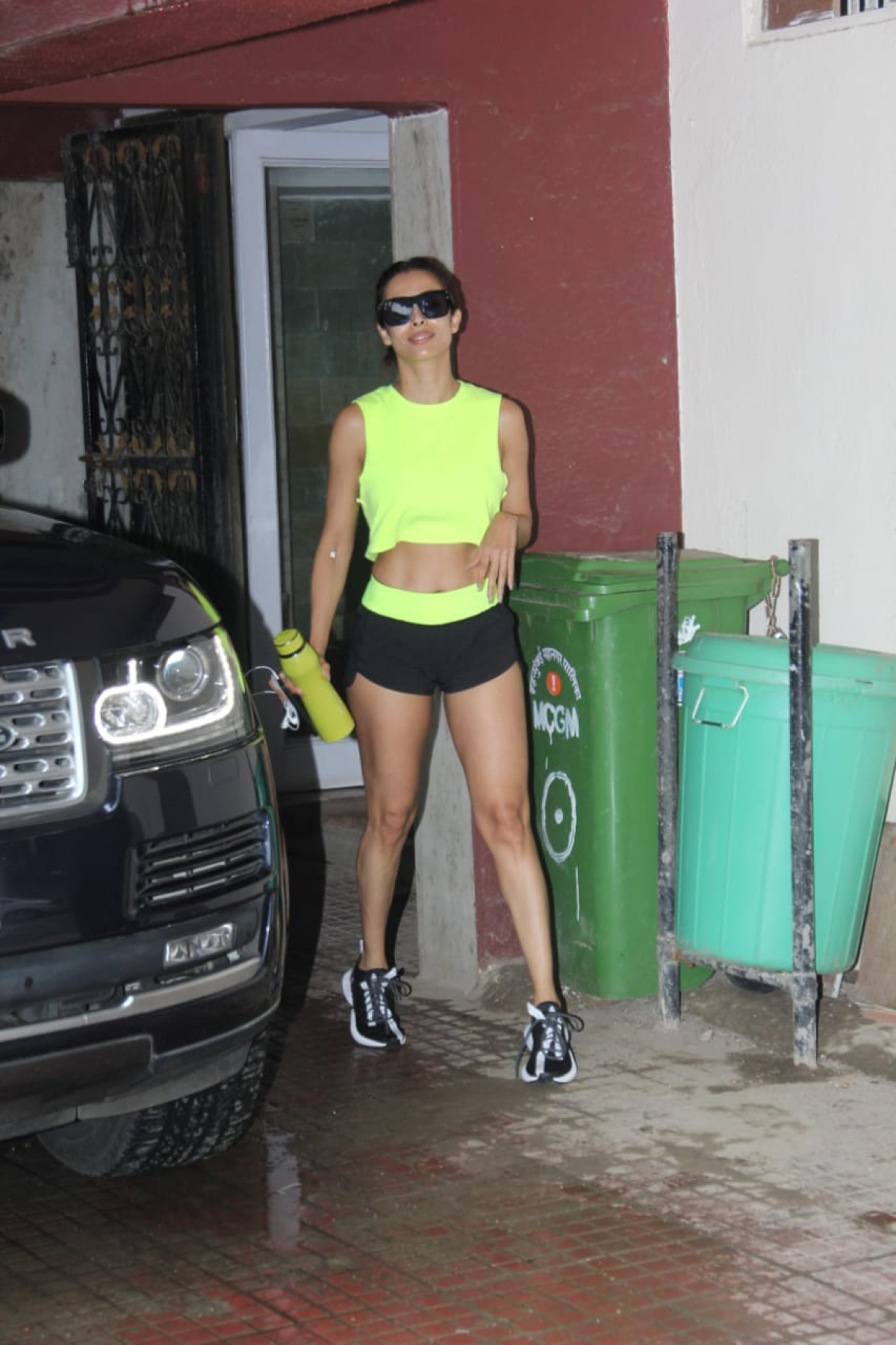 Malaika Arora Khan stepped out of the gym in a neon crop top and black shorts, sporting her abs as she walked to her car.
