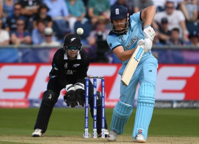 England's Jonny Bairstow (R) is watched by New Zealand's wicketkeeper Tom Latham as he plays a shot  during the 2019 Cricket World Cup group stage match between England and New Zealand at the Riverside Ground, in Chester-le-Street, northeast England, on July 3, 2019.