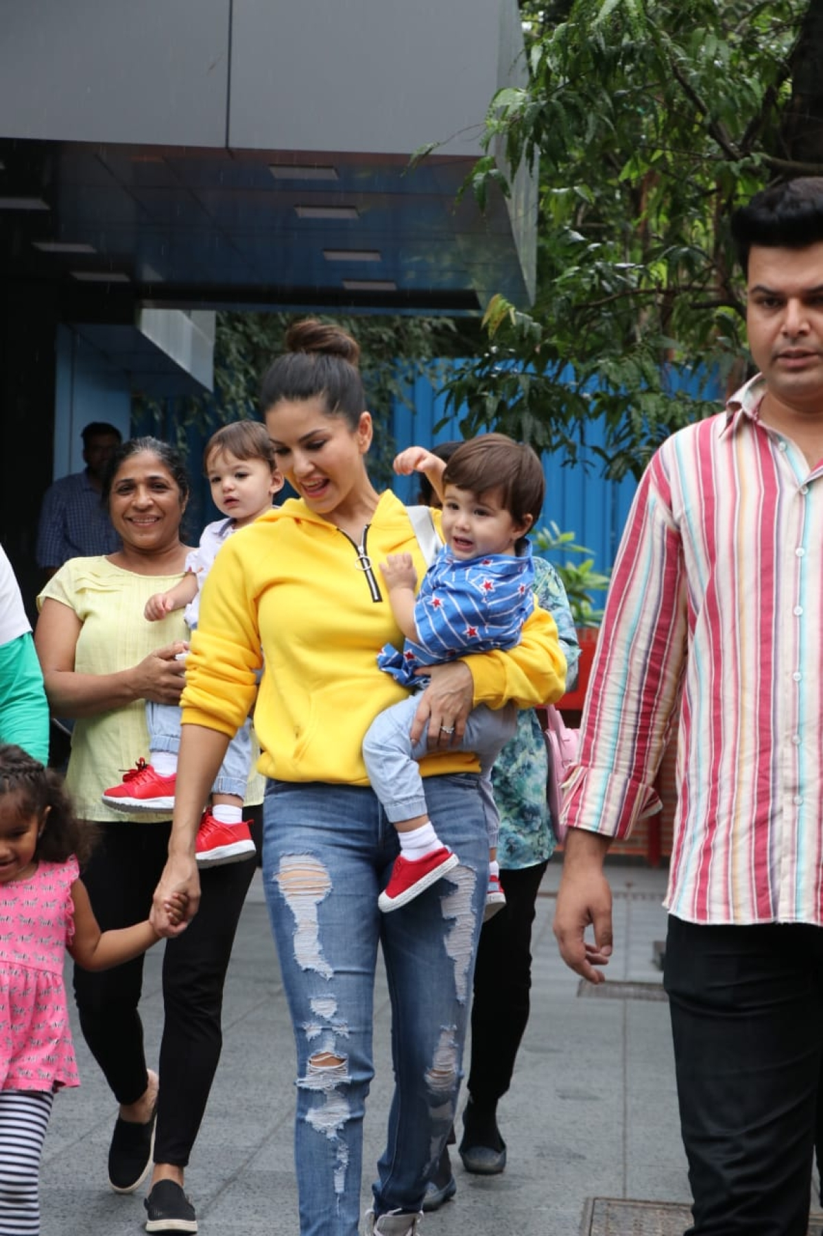 Sunny Leone was spotted with kids Nisha Kaur Weber, Noah and Asher at a play school in Juhu. In yellow sweat shirt and blue jeans the actress looked her usual chilled out self.