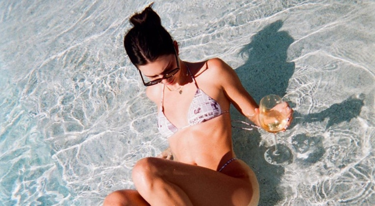 Kendall Jenner kicks off the #bottlecapchallenge in the water!