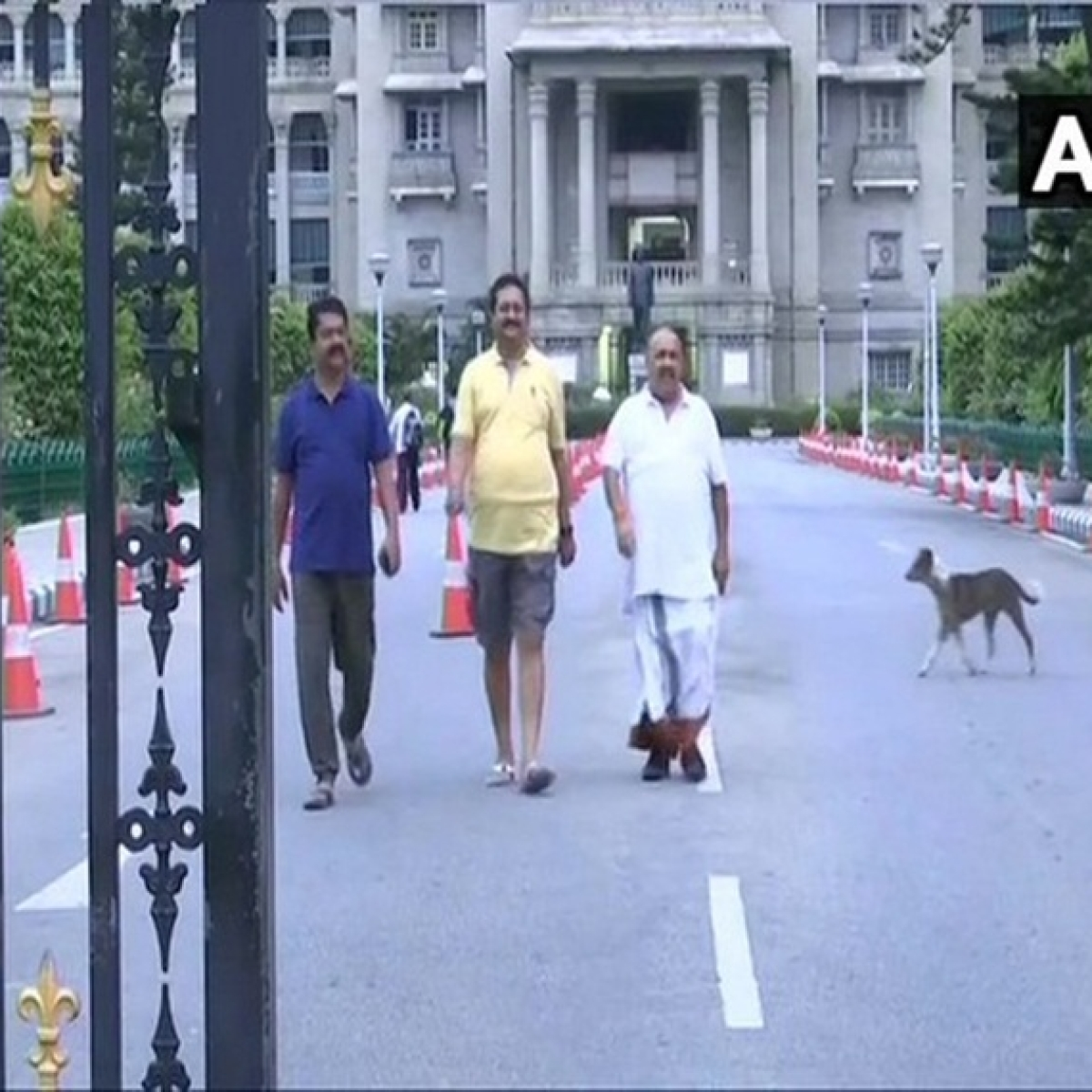 After night-long dharna inside house, BJP lawmakers take morning walk around Vidhana Soudha