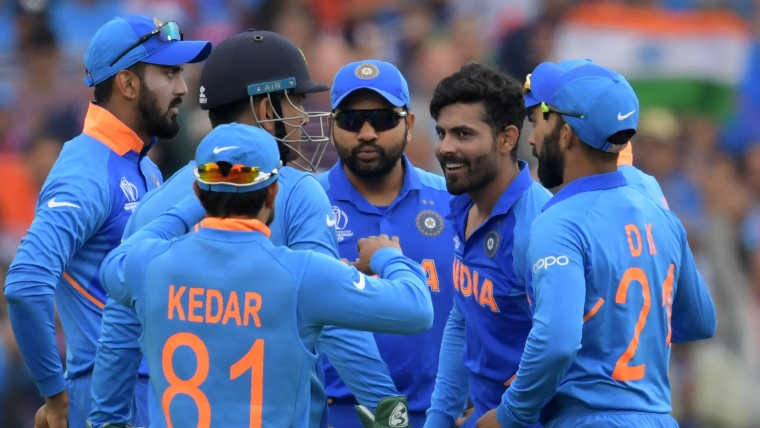 India's Ravindra Jadeja (2R) celebrates with teammates