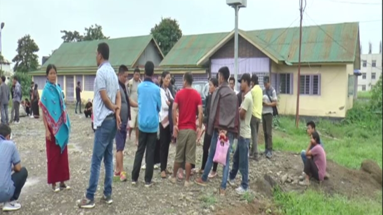 People gathered outside mortuary to mourn the killing of Kuki village chief and his nephew