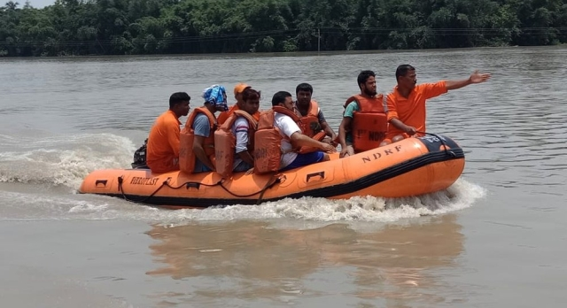 NDRF personnel during the rescue operation of residents from the flood-affected area of Morigaon