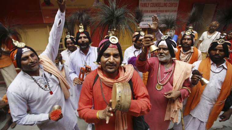 Sadhus chant religious slogans at Ram Mandir during the registration for annual Amarnath Yatra, in Jammu