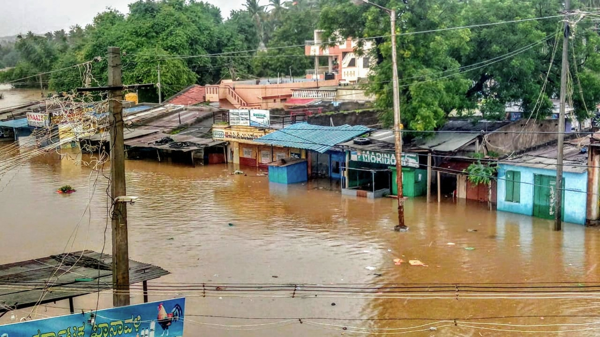 A view of Malaprabha river water flooding the Munavalli village after heavy rain, in Belgavi, Karnataka, Wednesday, Aug 7, 2019.