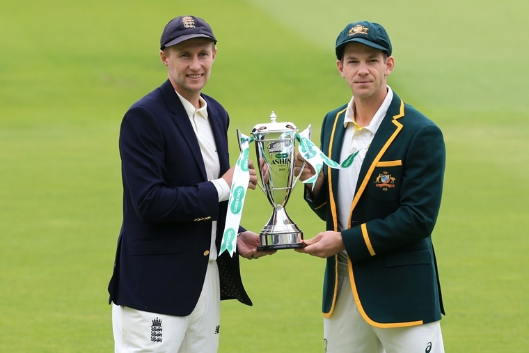 England's captain Joe Root (L) and Australia's captain Tim Paine hold the trophy for the Ashes series.