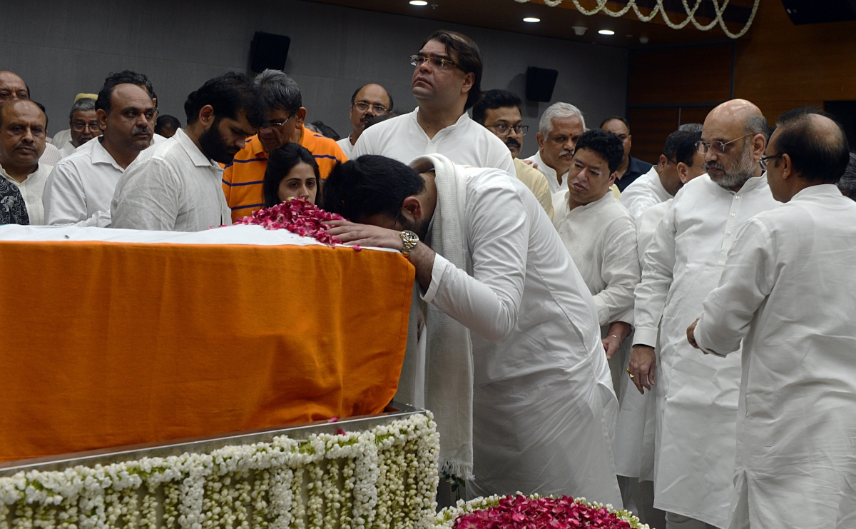 Rohan Jaitley son of former Finance Minister Arun Jaitley pays tributes during his last respects as Union Home Minister Amit Shah looks on at BJP headquarters in New Delhi