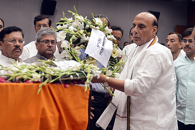 Defence Minister Rajnath pays floral tributes on the behalf of Prime Minister Narendra Modi during the last respects of former Finance Minister Arun Jaitley at BJP headquarters in New Delhi