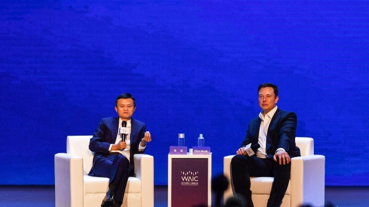 Elon Musk (R), Co-founder and CEO of Tesla, and Jack Ma, co-chair of the UN High-Level Panel on Digital Cooperation, speak onstage during the the World Artificial Intelligence Conference (WAIC) in Shanghai