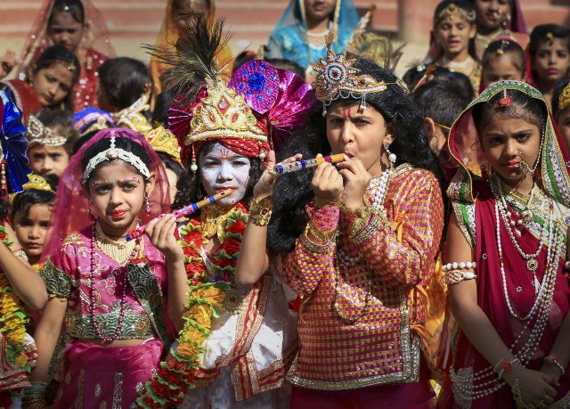Students dressed up as Lord Krishna and Radha take part in 'Janmashtami' festival celebrations, in Ajmer