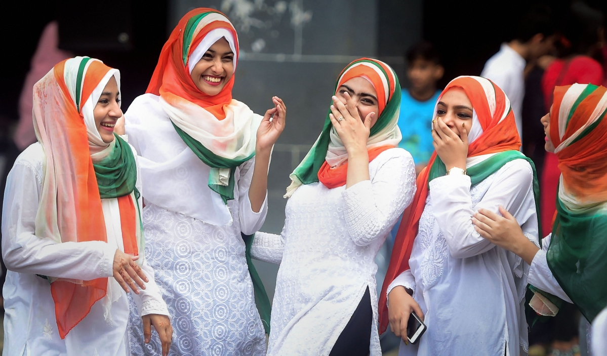 Students from the Anjuman Islam school share a light moment as they take part in the 73rd Independence Day celebrations, in Mumbai