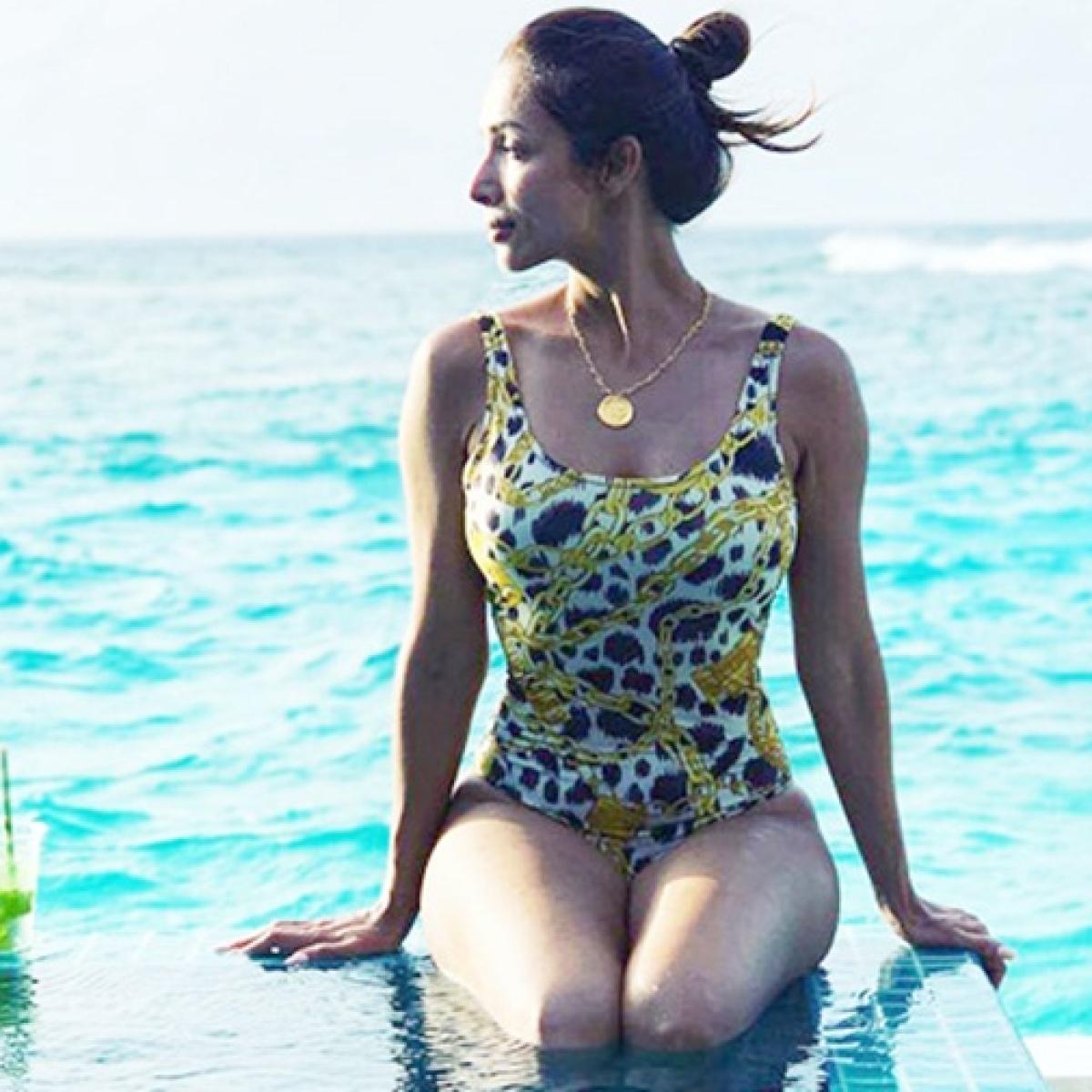 Malaika Arora flaunts her curves in a printed monokini
