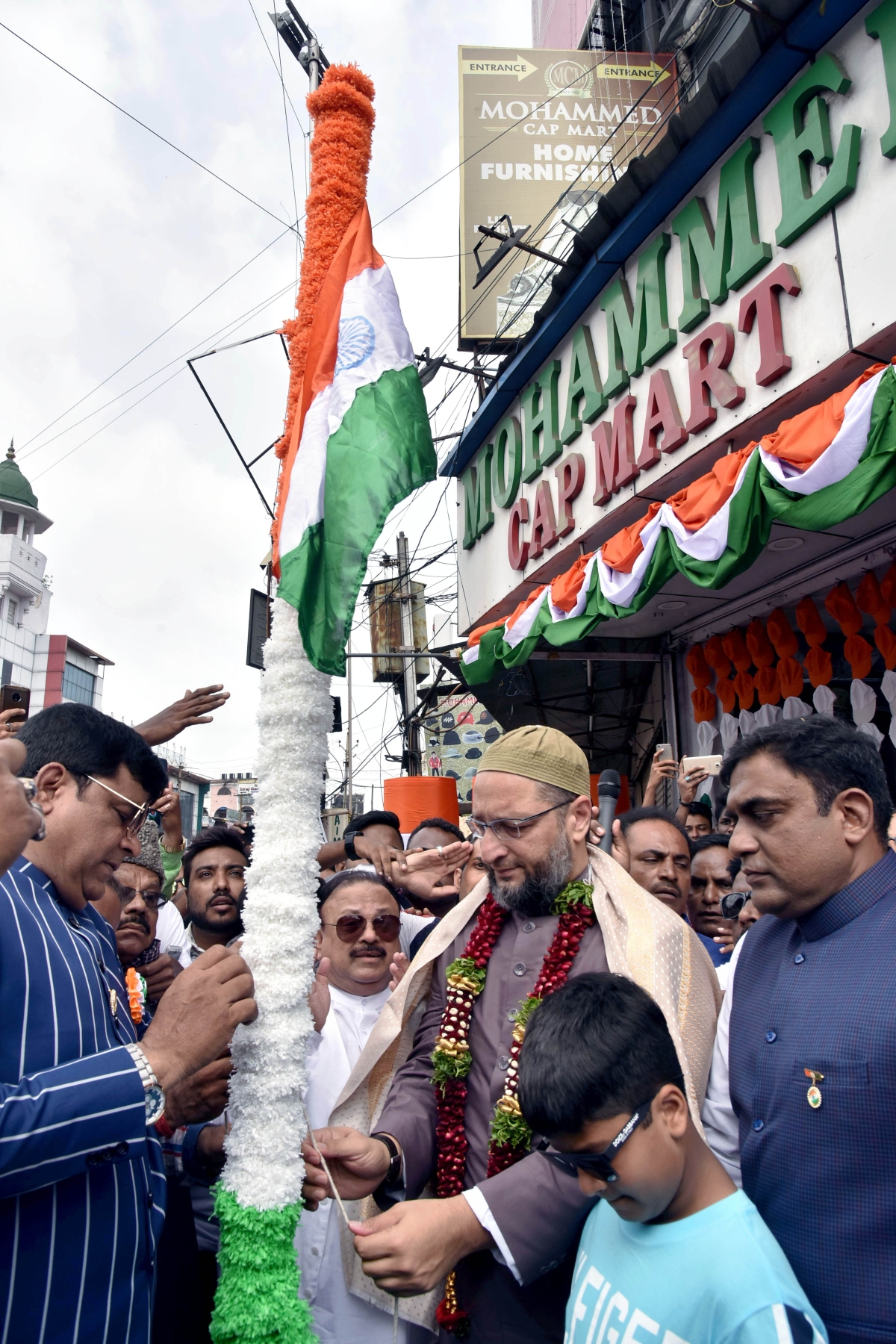 AIMIM President and Hyderabad MP Asaduddin Owaisi hoists National Flag to mark 73rd India Independence Day Celebrations in the old city of Hyderabad