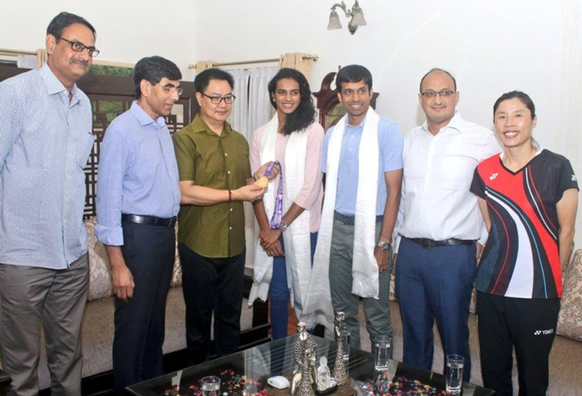 Minister presents Rs 10 lakh cheque to world champion Sindhu