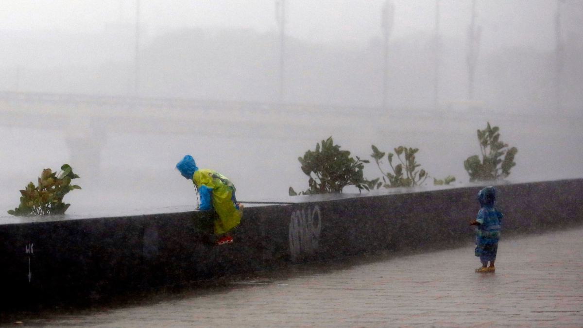 Two dead as Japan orders 870,000 to flee heavy rains