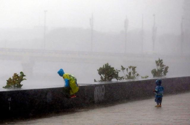 Kids enjoying during heavy rains at Worli Sea Face in Mumbai
