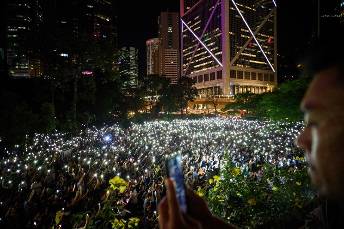"""Hong Kong protesters form human chain across city 30 years after """"Baltic Way"""""""