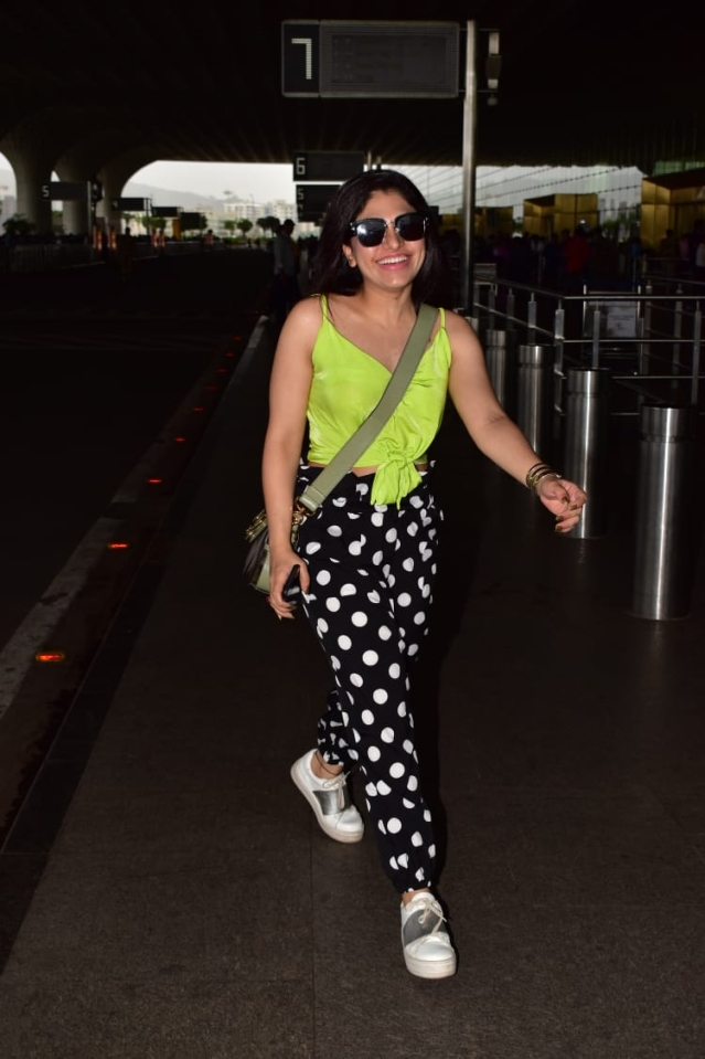 Singer Tulsi Kumar snapped at airport as she flew to Dubai.