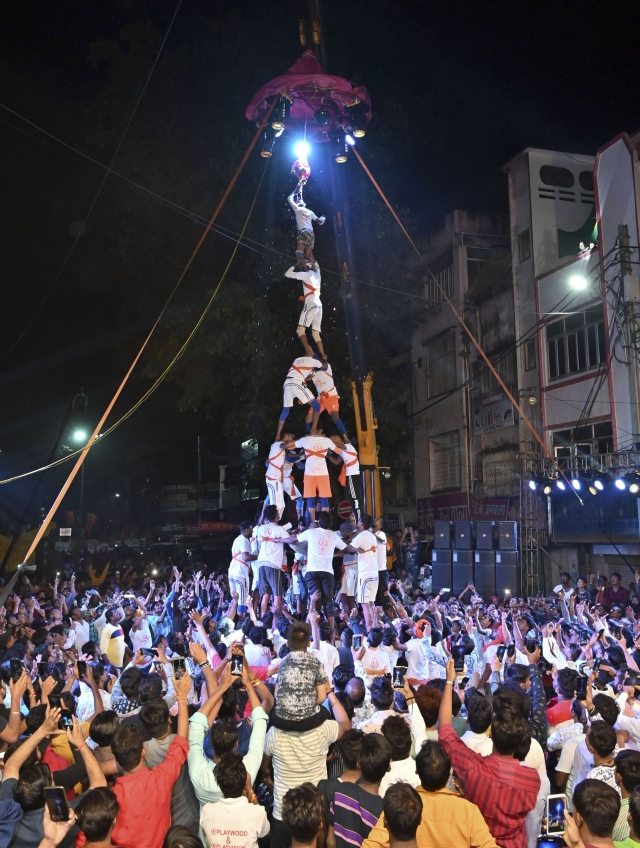 Participants form a human pyramid as they try to break 'Dahi-handi' during a competition on the occasion of Janmashtami festival at Kamania Gate, in Jabalpur