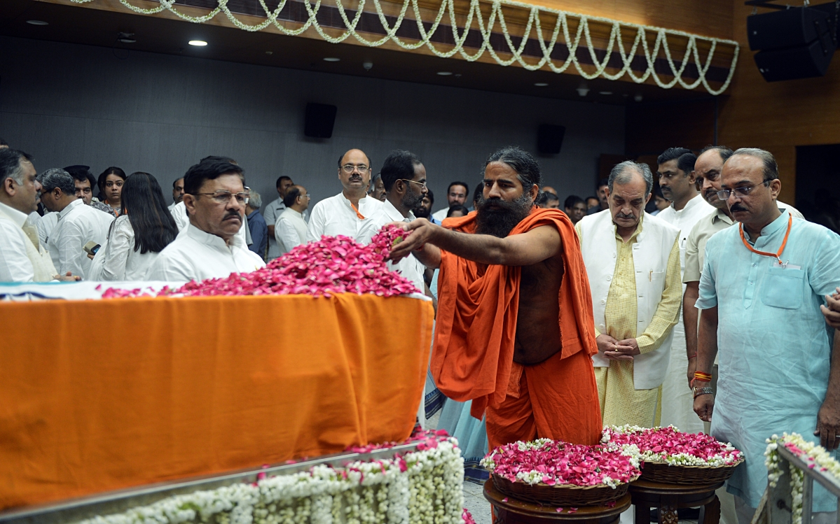 Yoga Guru Baba Ramdev pays floral tributes during the last respects of former Finance Minister Arun Jaitley at BJP headquarters in New Delhi