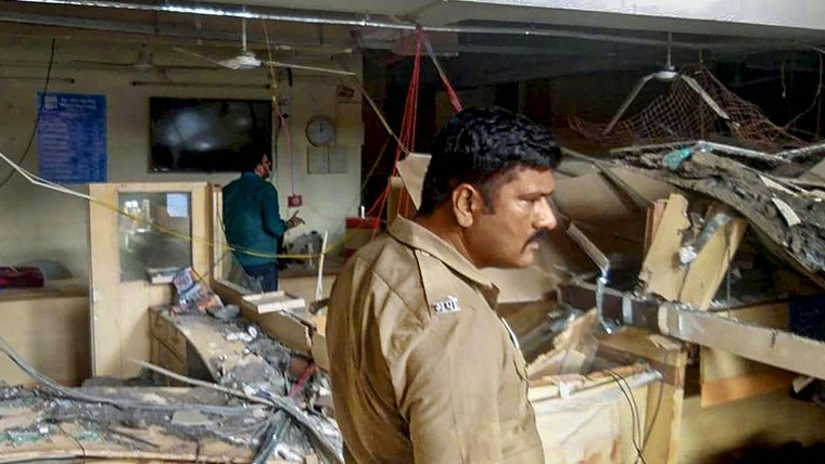 Solapur: A policeman at the rescue site where roof of the building that houses Bank of Maharashtra collapsed, at Karmala town in Solapur.