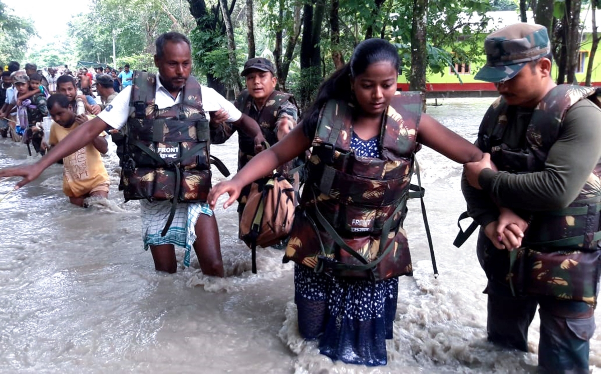 Indian army personnel rescue residents from the flood-affected Village Dhamdhama in Nalbari, Assam on Wednesday