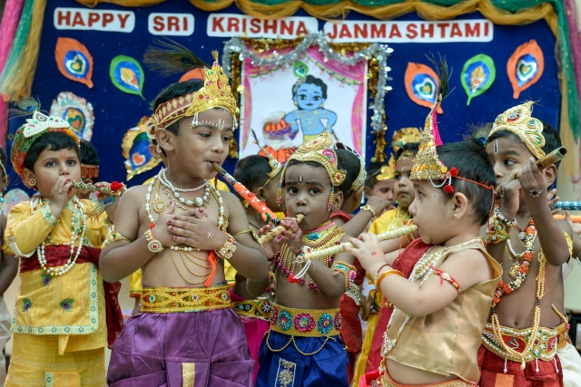 Children dressed as Hindu God Lord Krishna play flutes as they take part in celebrations on the occasion of Janamashtami, the birthday of Lord Krishna, in Hyderabad