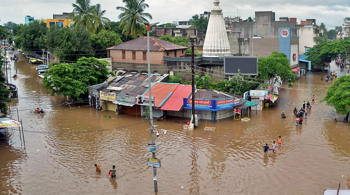 People wade through a flood street in Sangli, Maharashtra.