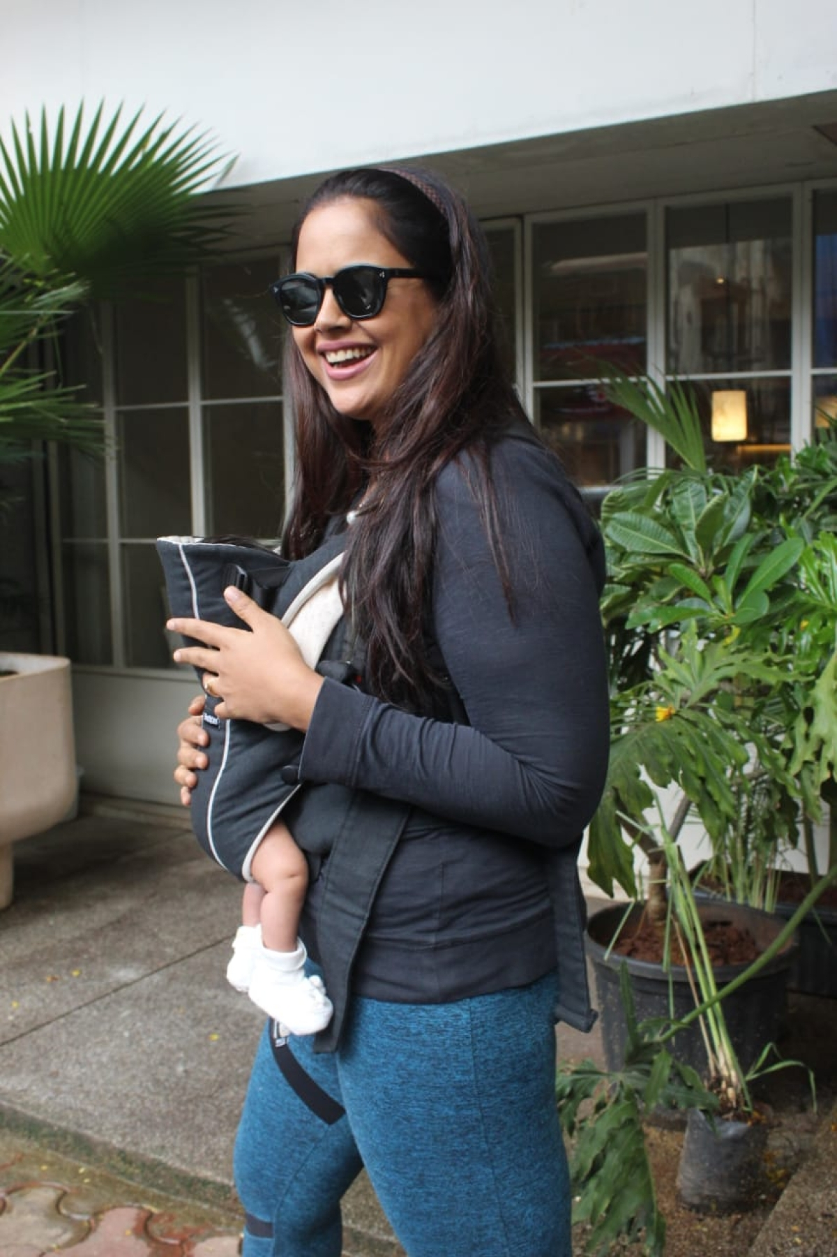 Sameera Reddy was clicked by media at Sequel in Bandra with her new-born baby girl Nyra.