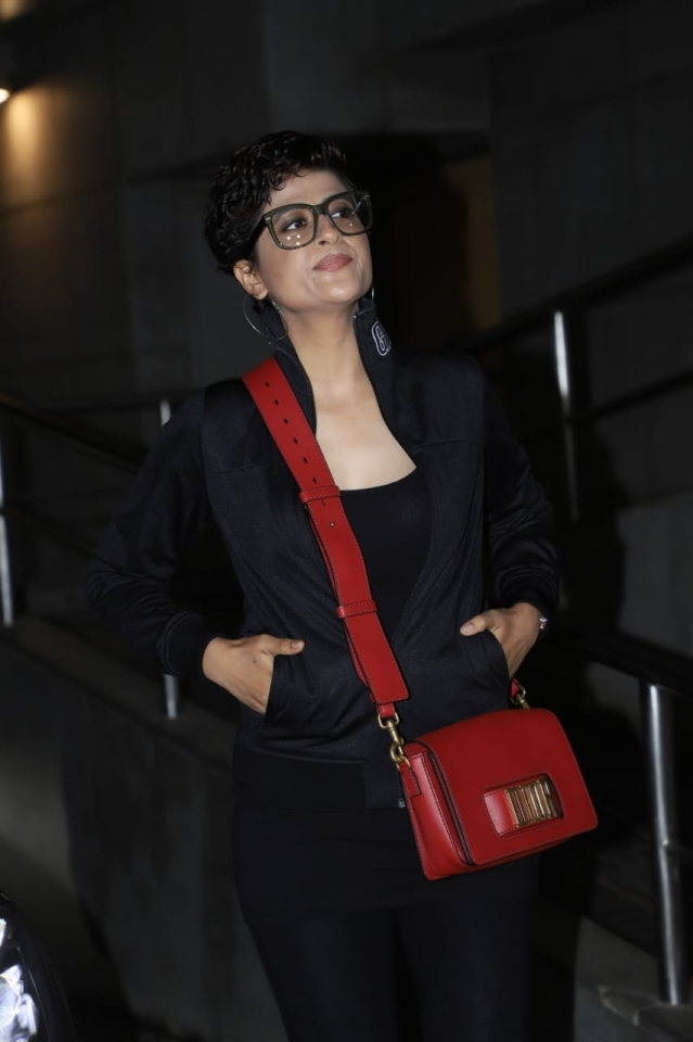Tahira Kashyap was snapped in all black with a Dior red purse