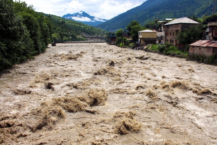 A view of the swollen Beas river following heavy monsoon rain, in Kullu,