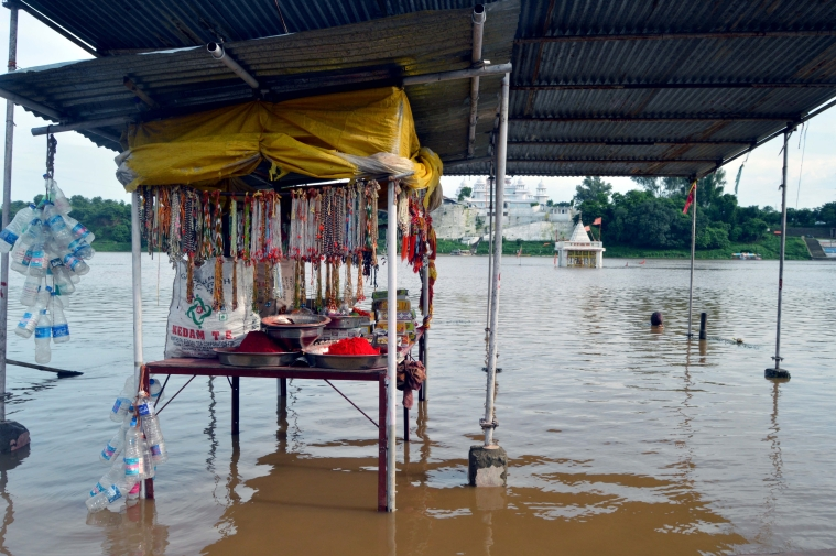 A general view of the flooded area at the temple of Gwarighat after heavy rain in Jabalpur on Tuesday.