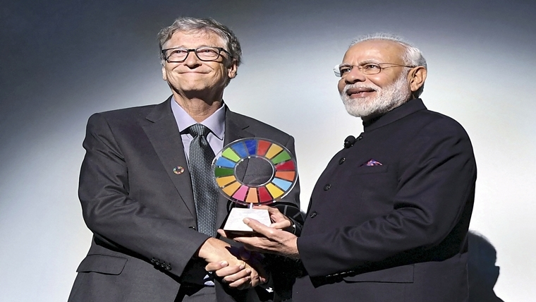 Prime Minister Narendra Modi is being presented the 'Global Goalkeeper Award? by Bill and Melinda Gates Foundation co-founder Bill Gates, for the Swachh Bharat Abhiyan launched by his government, in New York city