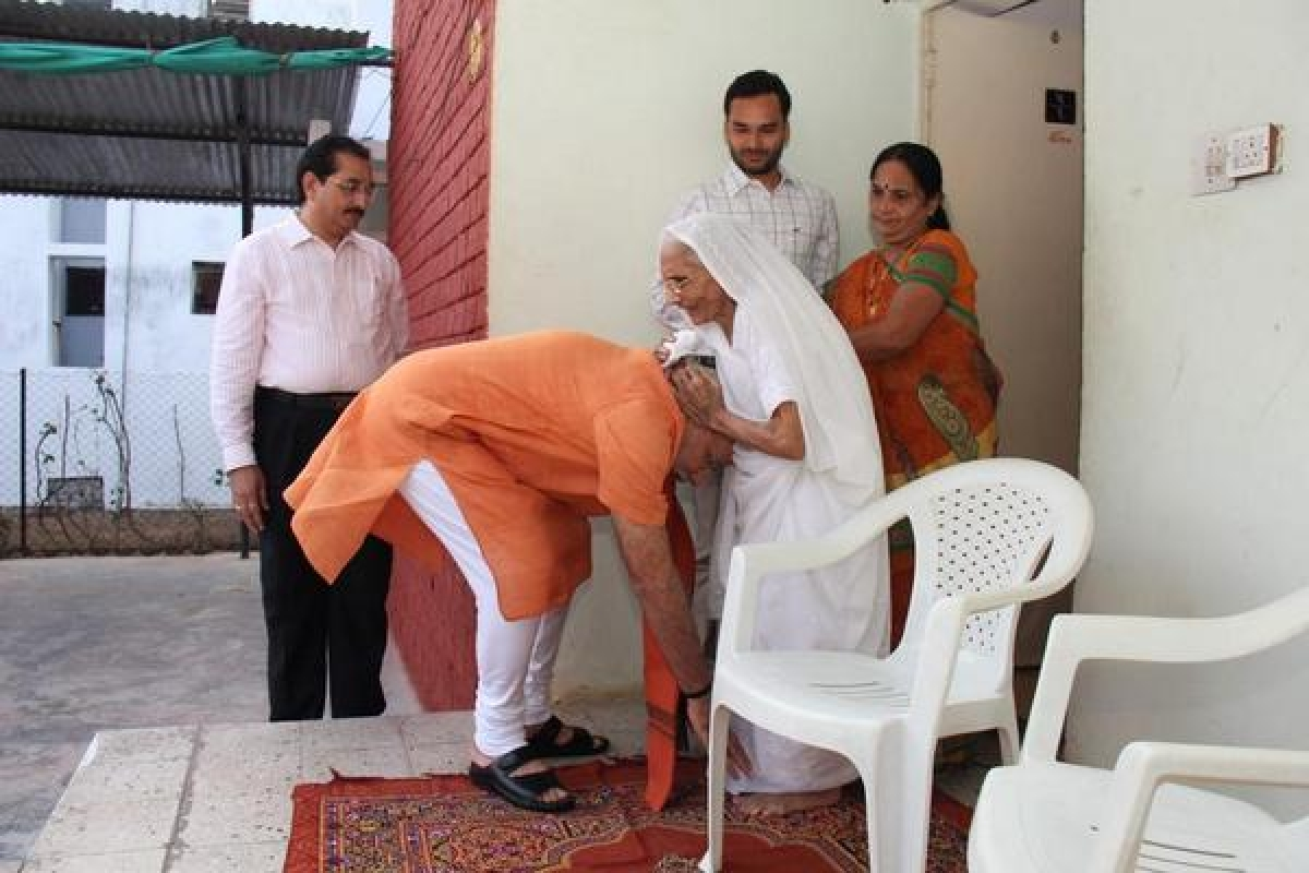 PM Narendra Modi by seeking blessings of his mother, Heeraba in Ahmedabad