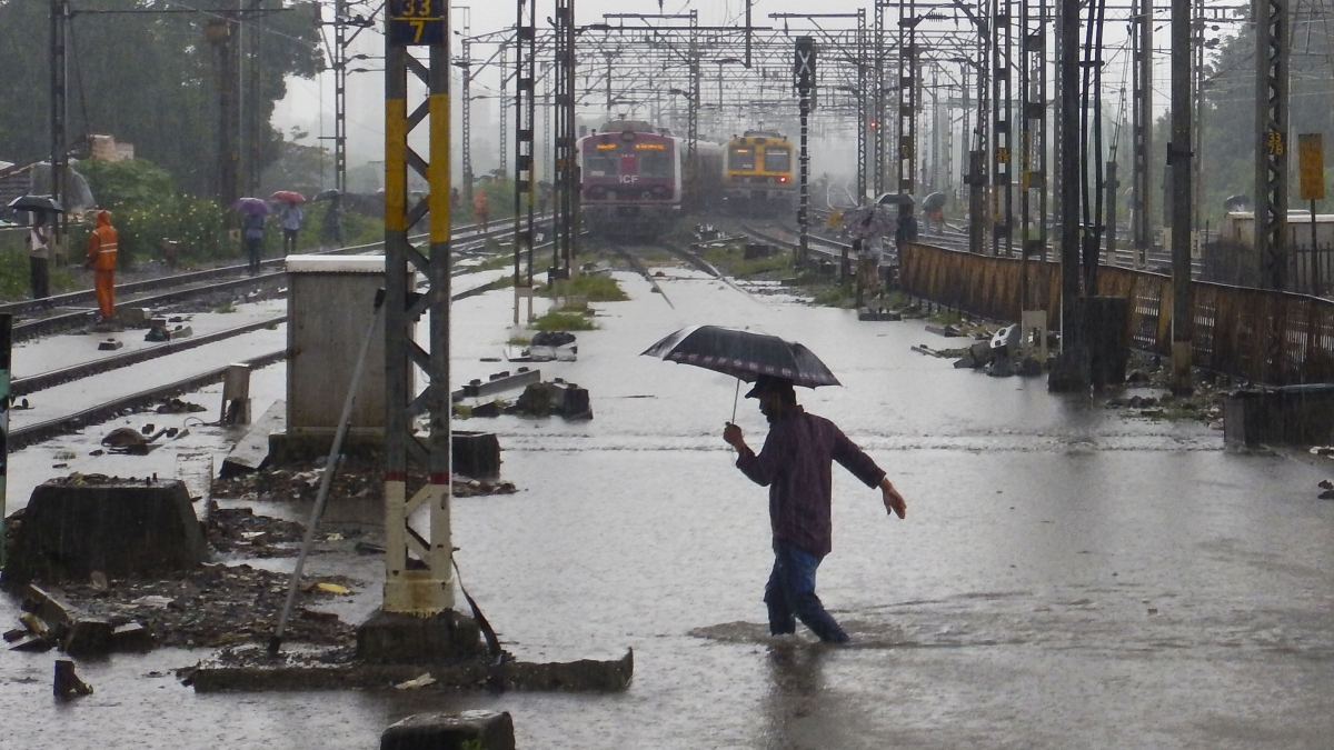 A view of waterlogged railway tracks following heavy rains in Thane, Wednesday, Sept. 4, 2019