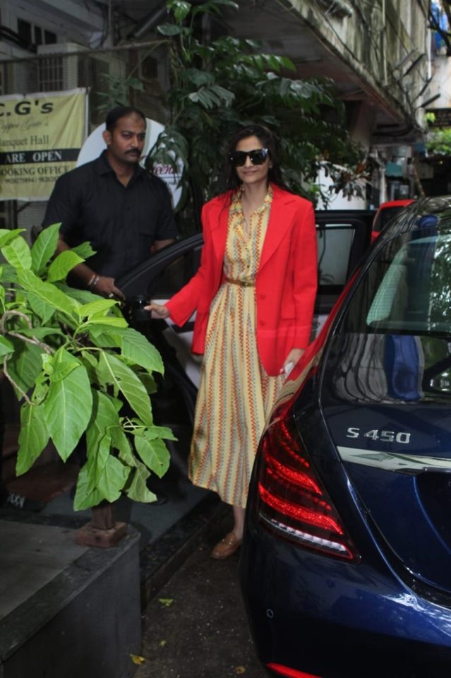 Sonam Kapoor is currently busy promoting her upcoming film, The Zoya Factor. The actress today was spotted in Krome studio in Bandra. She was snapped wearing a red jacket and Yellow shirt dress underneath.