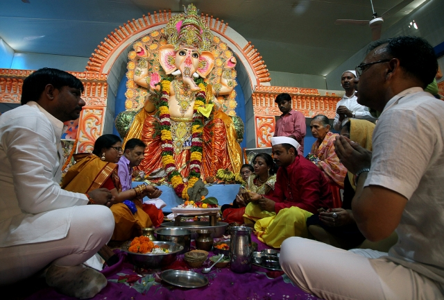 Devotees offering prayers after the installation of an idol of Lord Ganesh at Patrakarpuram Ganesh Puja Pandaal on the occasion of Ganesh Chaturthi in Lucknow