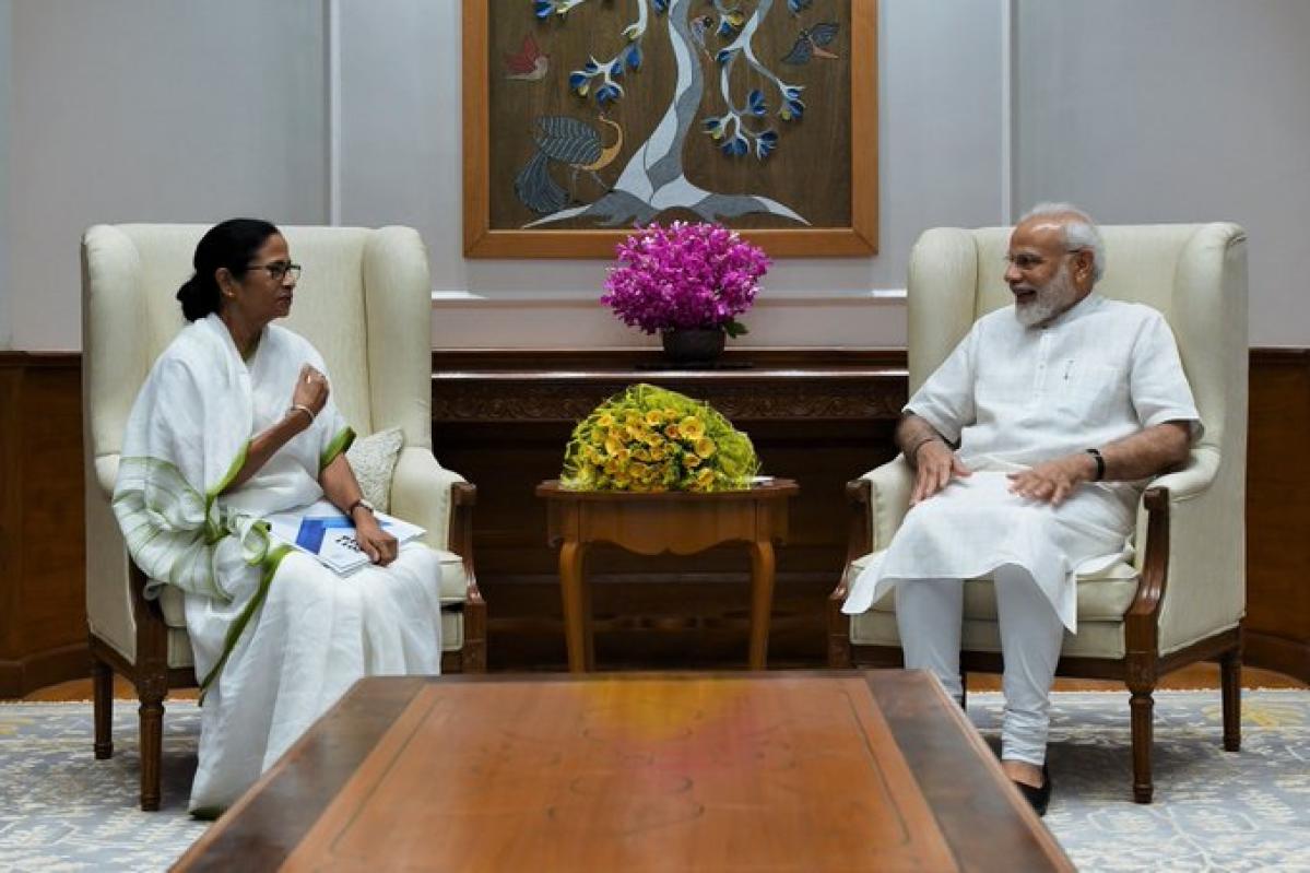 Mamata Banerjee meets Narendra Modi at his residence in Delhi.