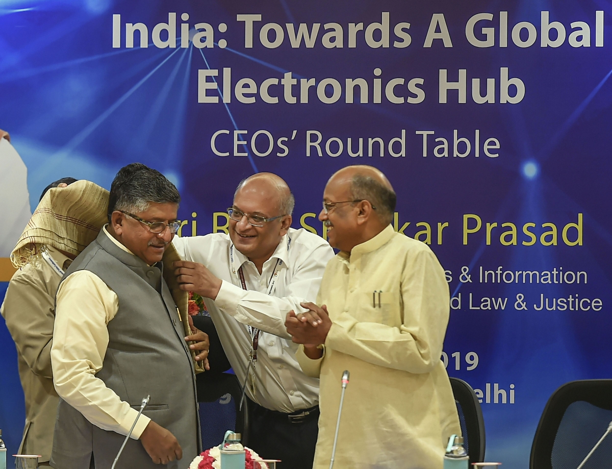 Union Minister for Communications, Electronics and IT Ravi Shankar Prasad is felicitated as he arrives to attend a round table discussion with CEOs' on 'India: Towards A Global Electronic Hub', at Vigyan Bhavan, in New Delhi, Monday, Sept. 16, 2019. MoS for Communications Sanjay Dhotre is also seen.