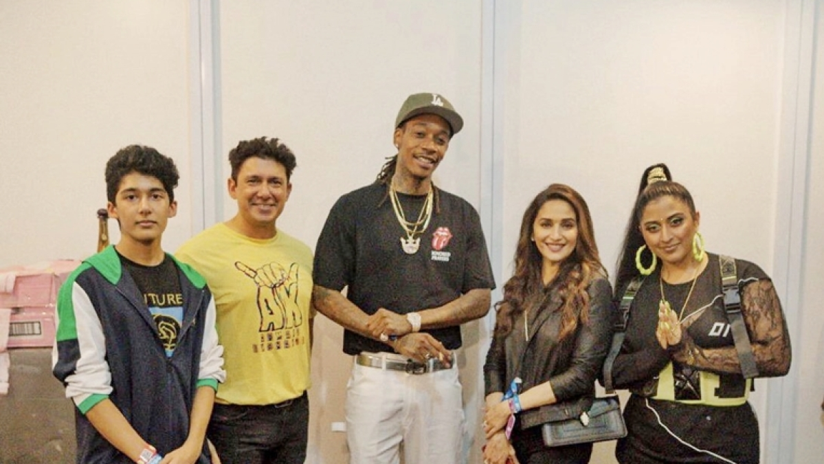 Madhuri Dixit poses with rapper Wiz Khalifa and Raja Kumari at Mumbai concert