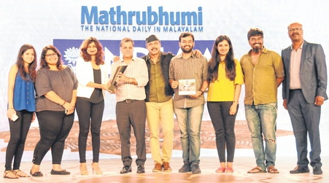 Raj Nayak, Past President IAA and Kamal Krishnan,  National Head, Integrated Media Solutions,  Mathrubhumi presented the trophy to  winner—P&G India team.